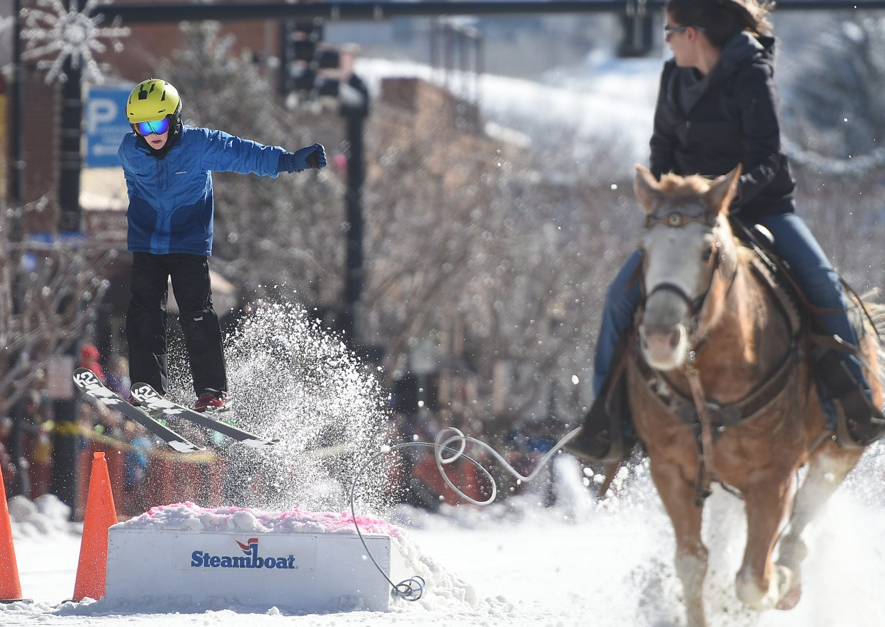 A skier catches air Sunday during Winter Carnival.