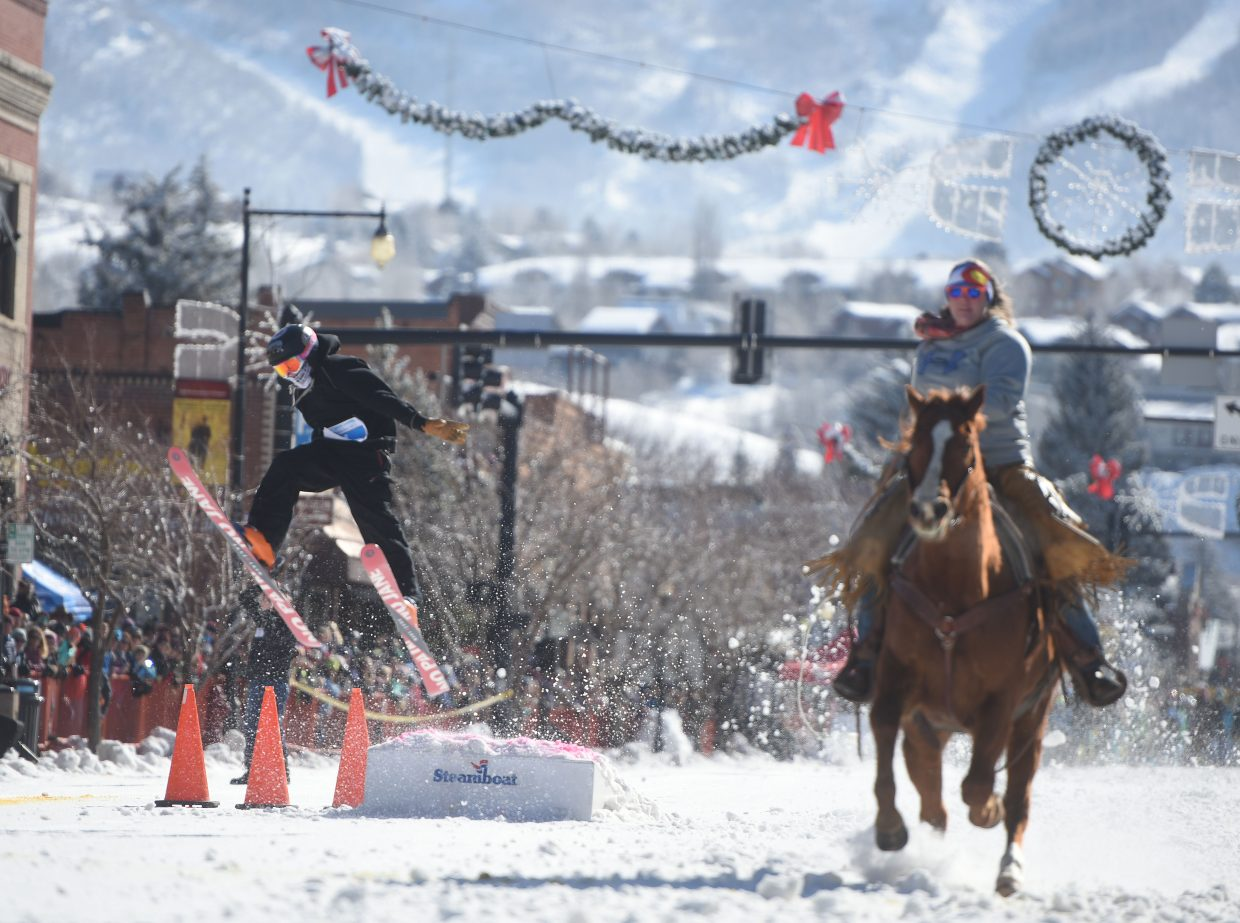 A skier takes a flying leap off the donkey jump Sunday during the Winter Carnival.
