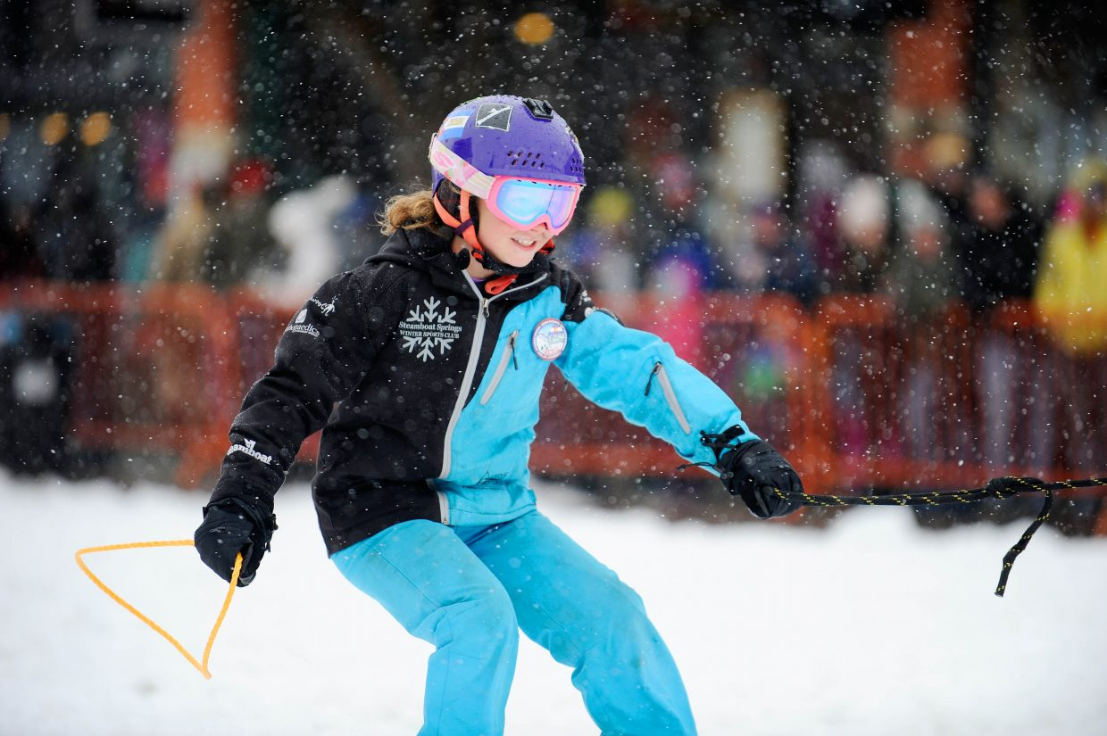 Hailey Bender competes in the Ring & Steer competition Saturday during the Steamboat Springs Winter Carnival Street Events.