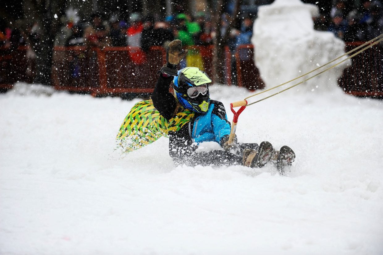 Rory Clow competes in the Shovel Race competition Saturday during the Steamboat Springs Winter Carnival Street Events.