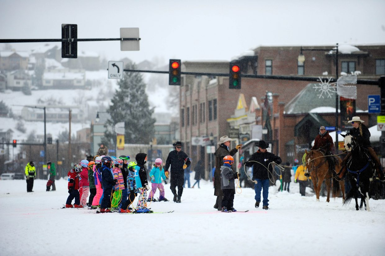Kids line up for the Ring & Steer competition Saturday during the Steamboat Springs Winter Carnival Street Events.