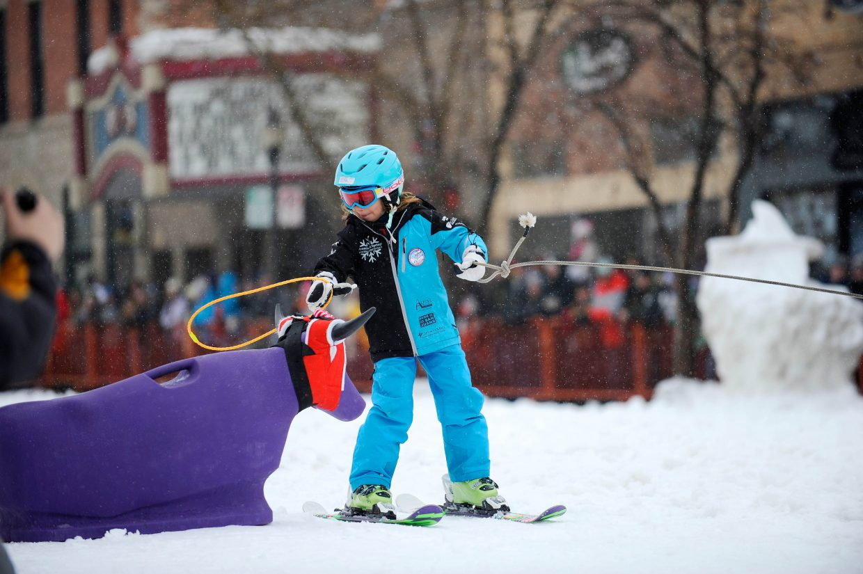 Eva Minotto competes in the Ring & Steer competition Saturday during the Steamboat Springs Winter Carnival Street Events.
