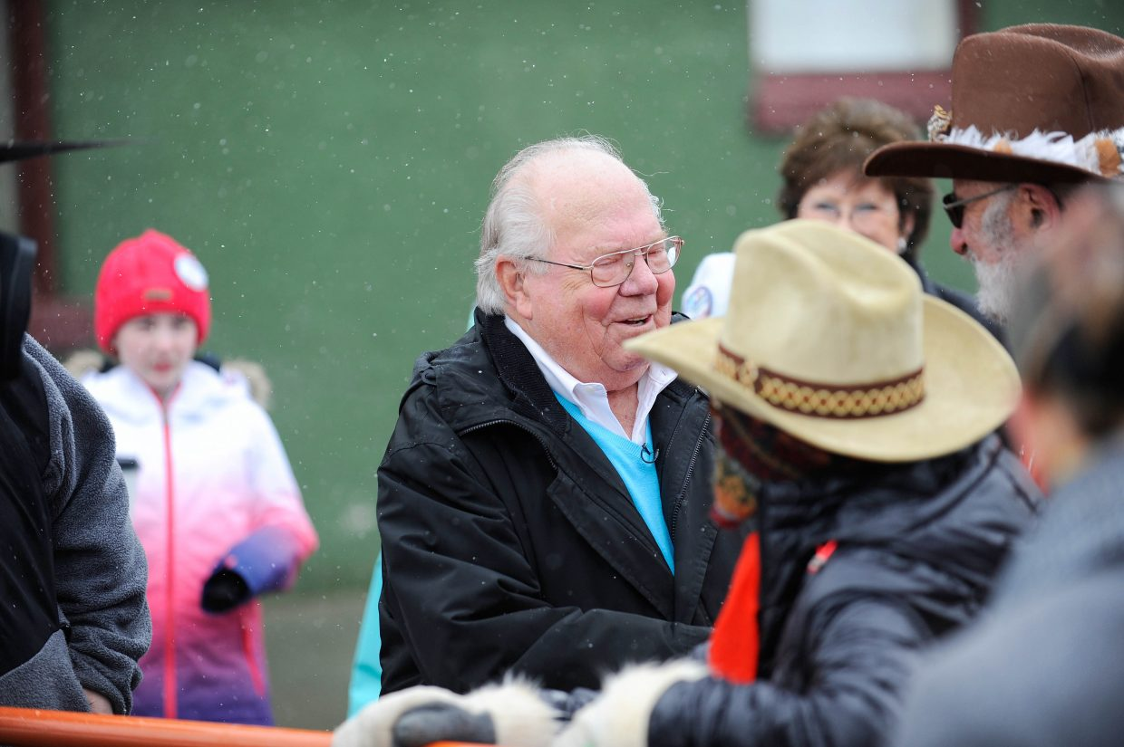 Steamboat Springs sportscaster Verne Lundquist visits fans Saturday during the Steamboat Springs Winter Carnival Street Events.