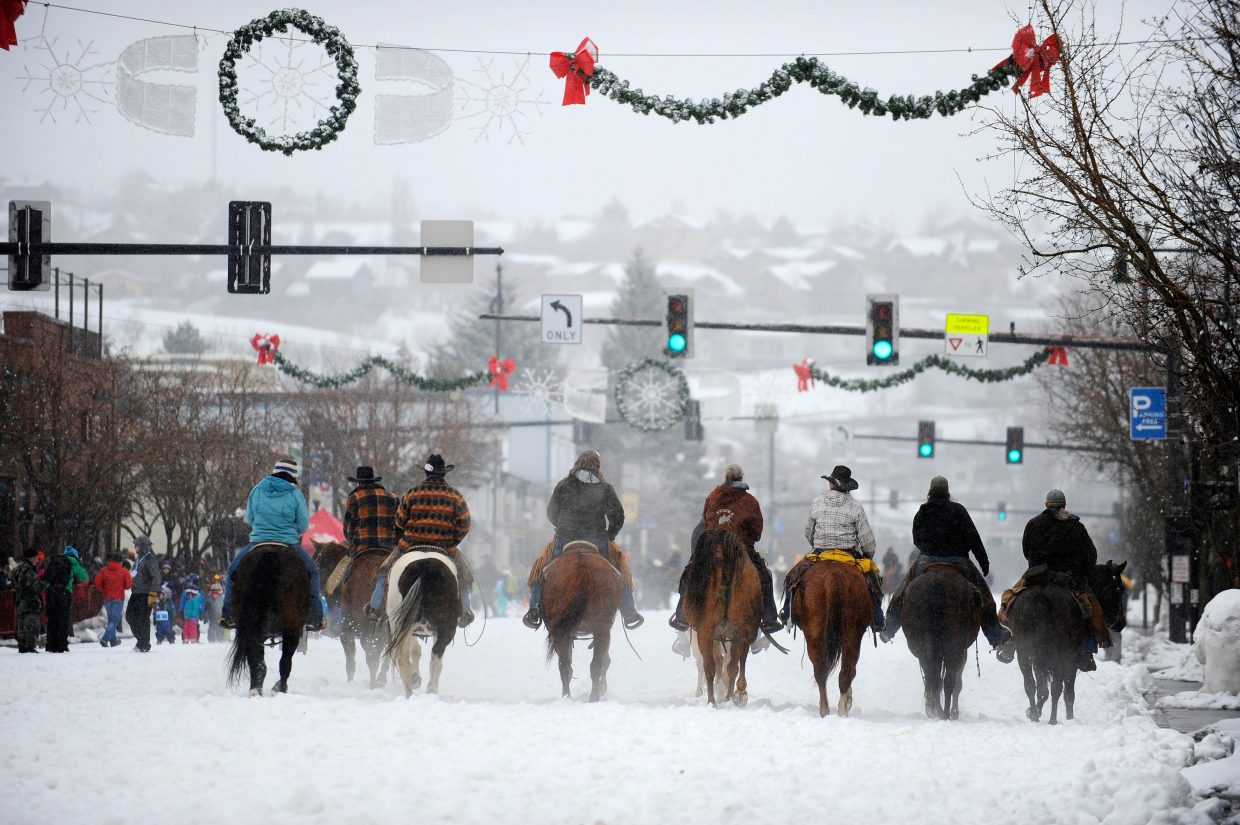 Horses walking down Lincoln Avenue Saturday during the Steamboat Springs Winter Carnival Street Events.