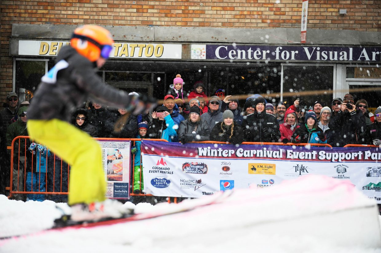 A Skier competes in the Donkey Jump competition Saturday during the Steamboat Springs Winter Carnival Street Events.