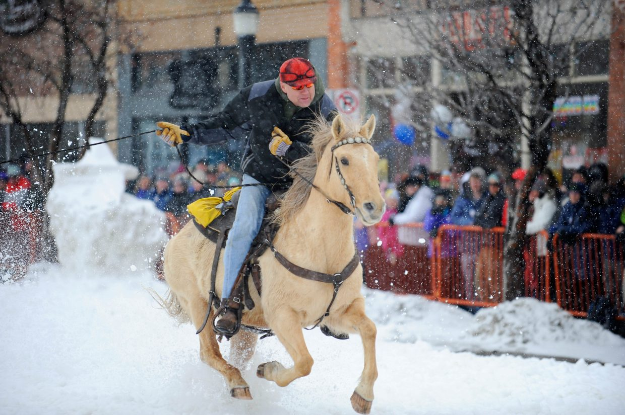 Bob Yeager pulls a skier Saturday during the Steamboat Springs Winter Carnival Street Events.