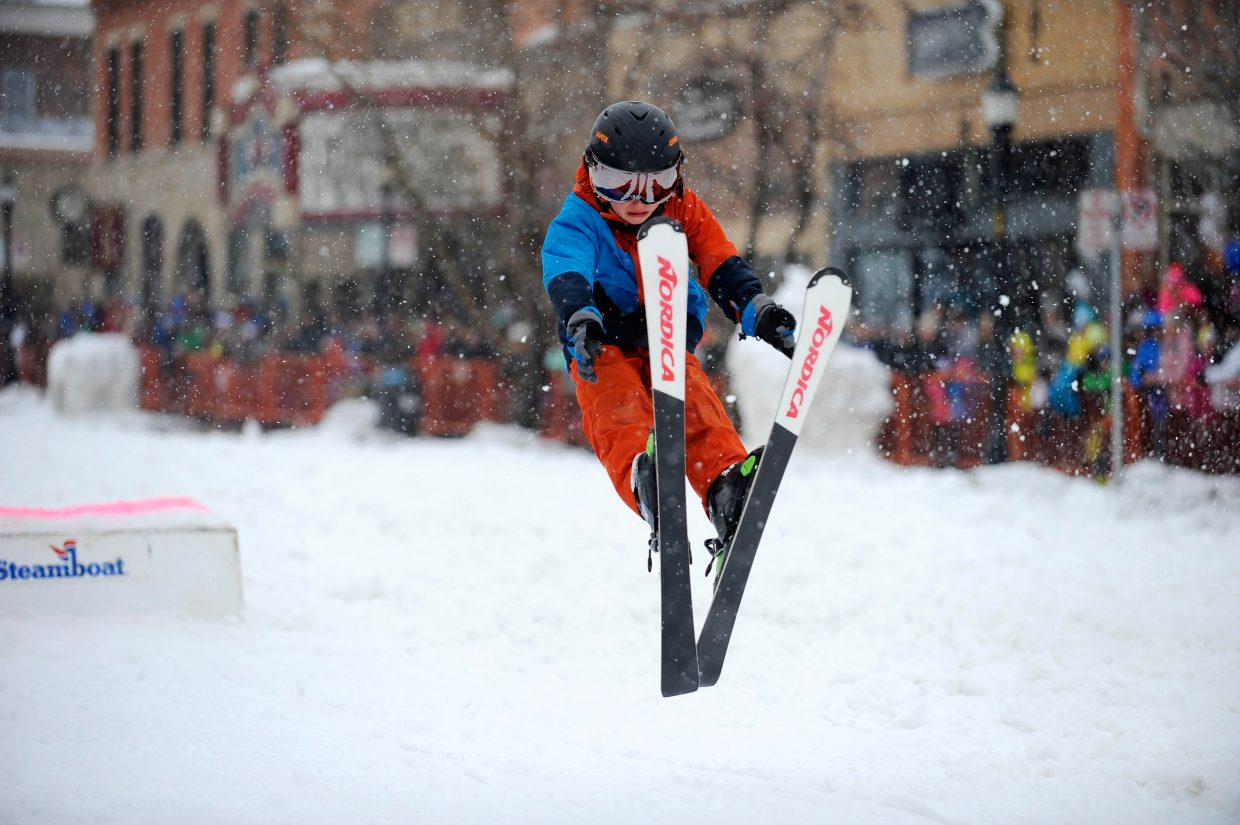 Oscar Dalzell flies off the jump in the Donkey Jump competition Saturday during the Steamboat Springs Winter Carnival Street Events.
