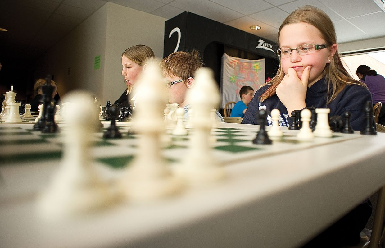 Kendall Harrington contemplates her next move during a chess tournament at Strawberry Park Elementary School on Wednesday afternoon. The chess tournament drew more the 50 students, a record tournament for the club, which has been part of the school for the past seven years.