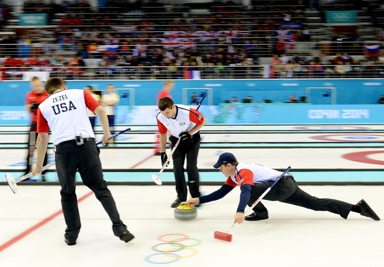 U.S. curling team skip John Shuster delivers the rock Thursday in a match against Great Britian.