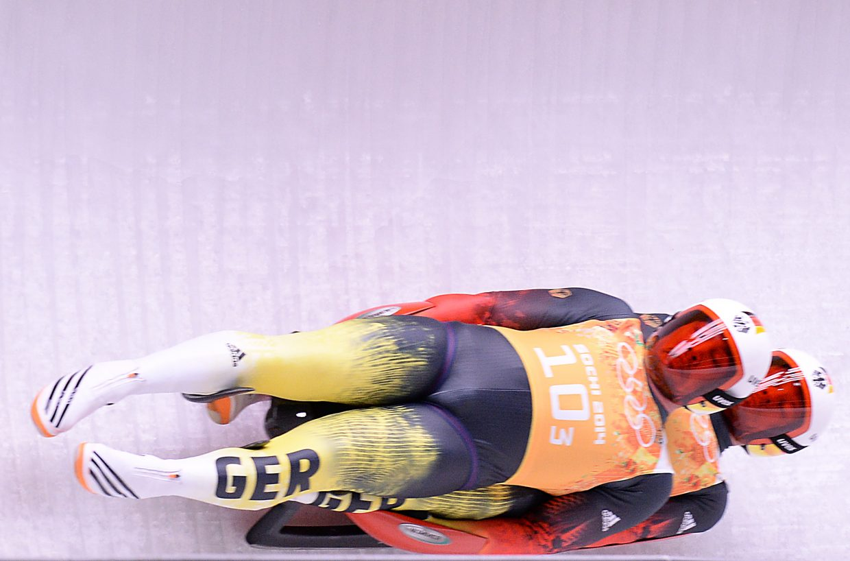 The German two-man luge team of Tobias Wendl and Tobias Arlt fly down the track at the Sanki Sliding Center in Krasnaya Polyana, Russia on Thursday. The Germans won the event, their fourth gold medal in luge at the 2014 Winter Olympics.