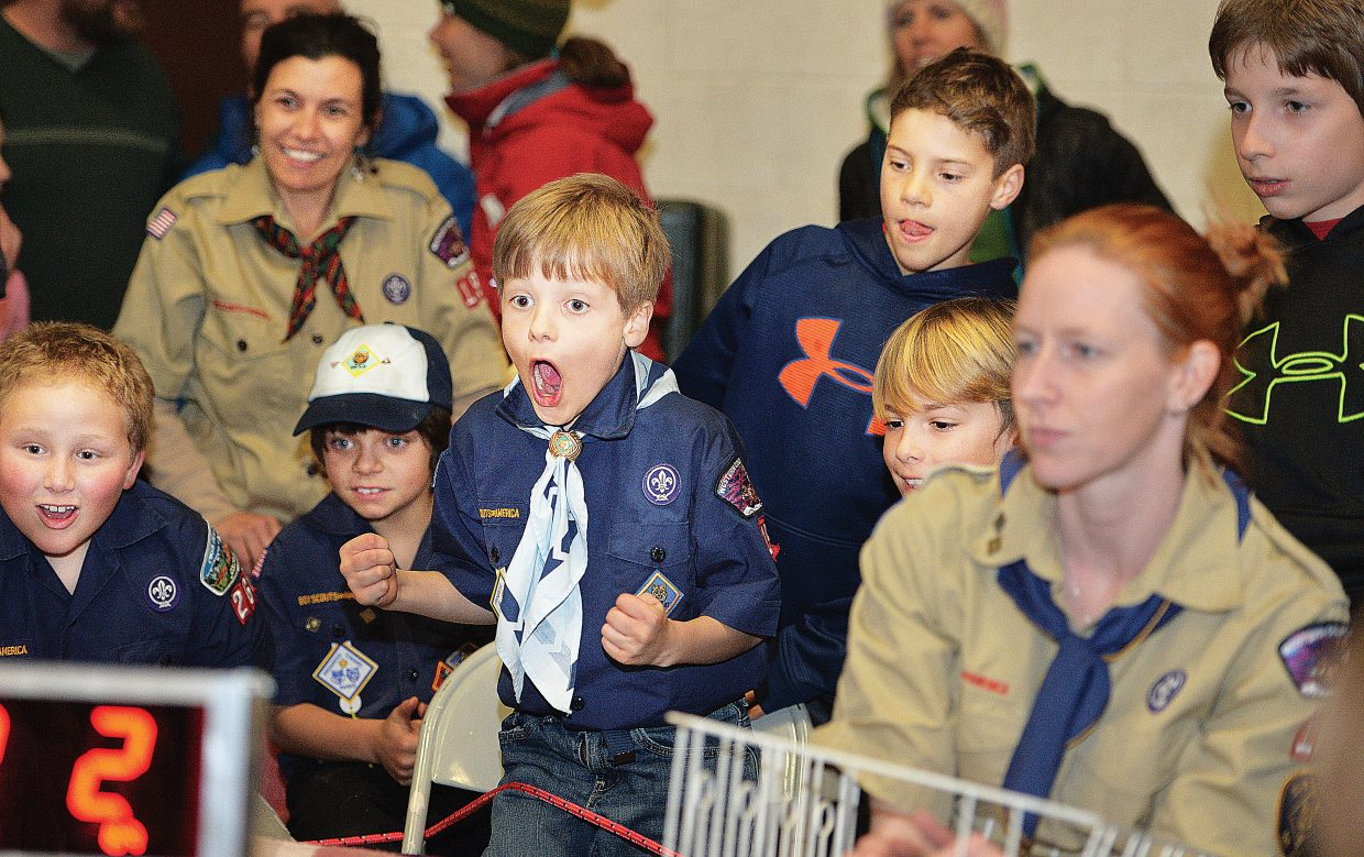 Thomas Mauldin cheers as his car approaches the finish line at the Cub Scout's Pinewood Derby event Wednesday evening at the Steamboat Springs Middle School.