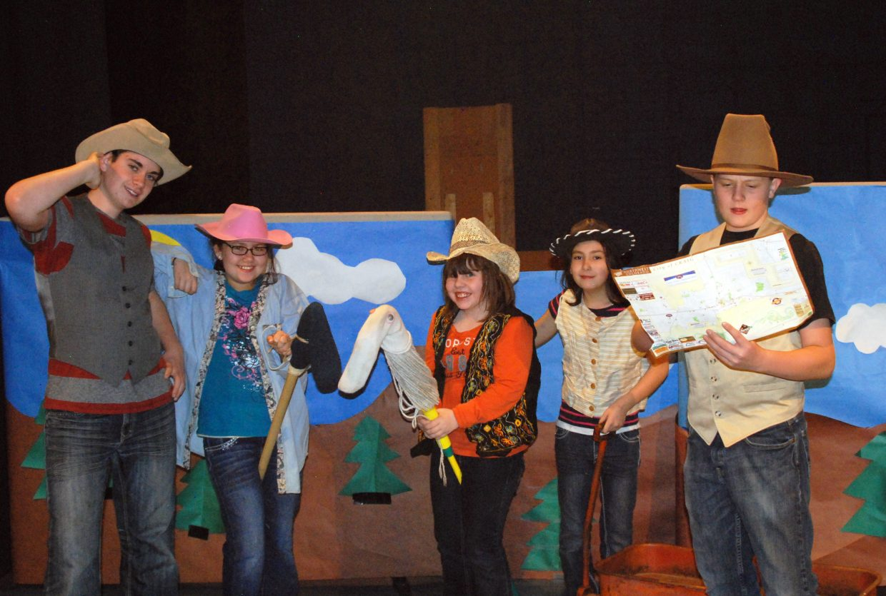 """From left, Brandon Christensen, Carmelita Bays, Amelia Seim, SaraJo Smith and Dylan Kernen have some Western fun while rehearsing the show """"The Taming of the Wilderness."""" The play, written and directed by David Morris, is loosely based on the founding of Craig and features performances Feb. 20 and 21."""
