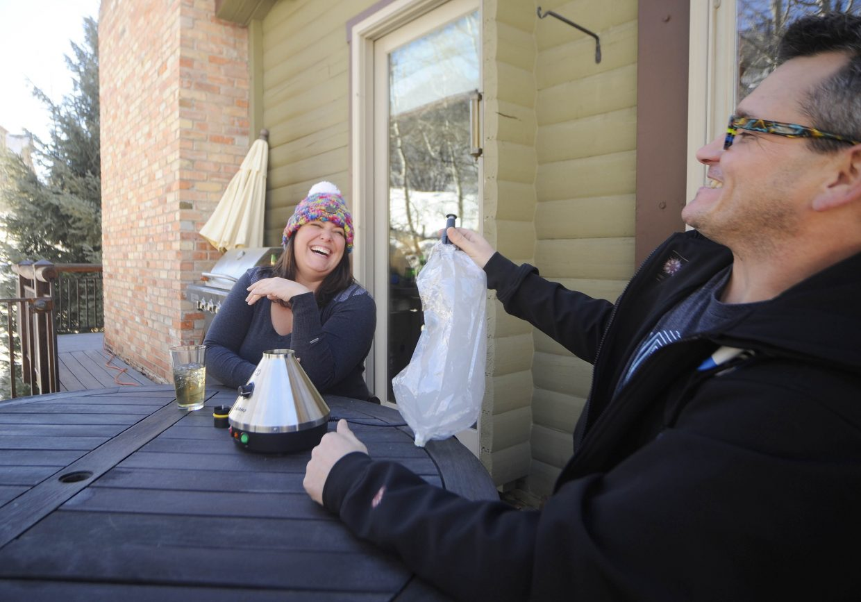 Steamboat Springs visitors Erica Fischer and John Ihrig get high Sunday using a Volcano vaporizer that a company called Steamboat420 began renting in October.