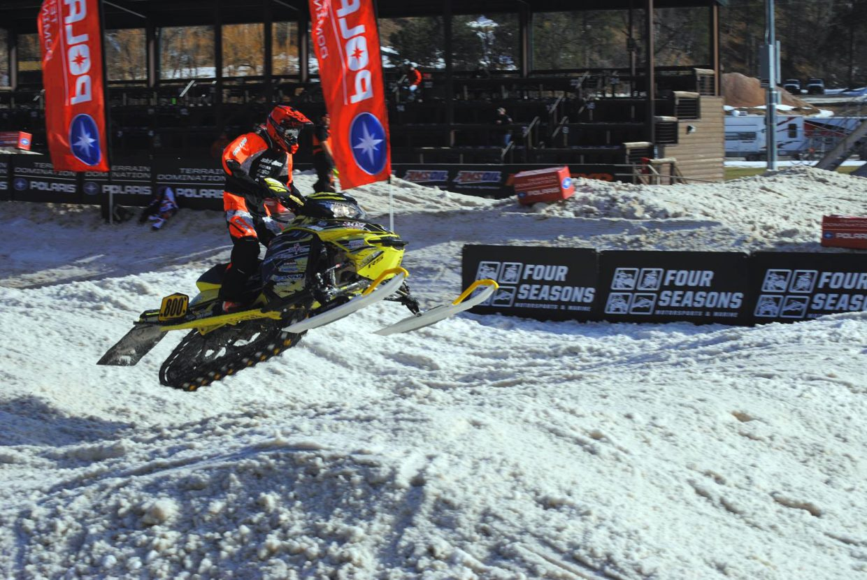 AJ Stoffle takes a jump with gusto during the Deadwood ShootOut race in Deadwood, South Dakota in late January. Stoffle is currently competing in the Sport class of the International Series of Champions circuit for snocross. He has been racing snowmobiles since the age of 4.