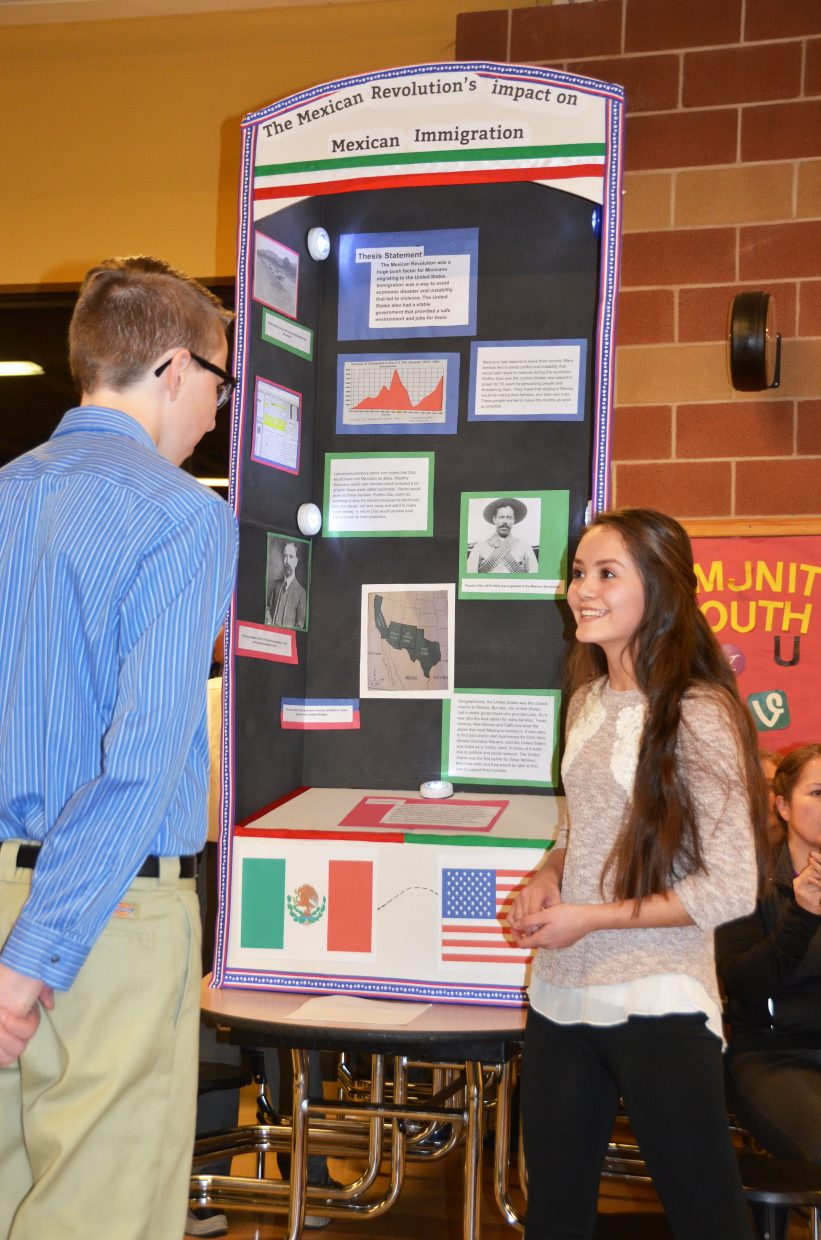 Marlyn Arellano, a 13-year-old eighth-grader at Craig Middle School, looked at the impact of the Mexican Revolution on immigration into the United States for her National History Day project. Here she talks with fellow Craig Middle School eighth-grader Owen Allen.