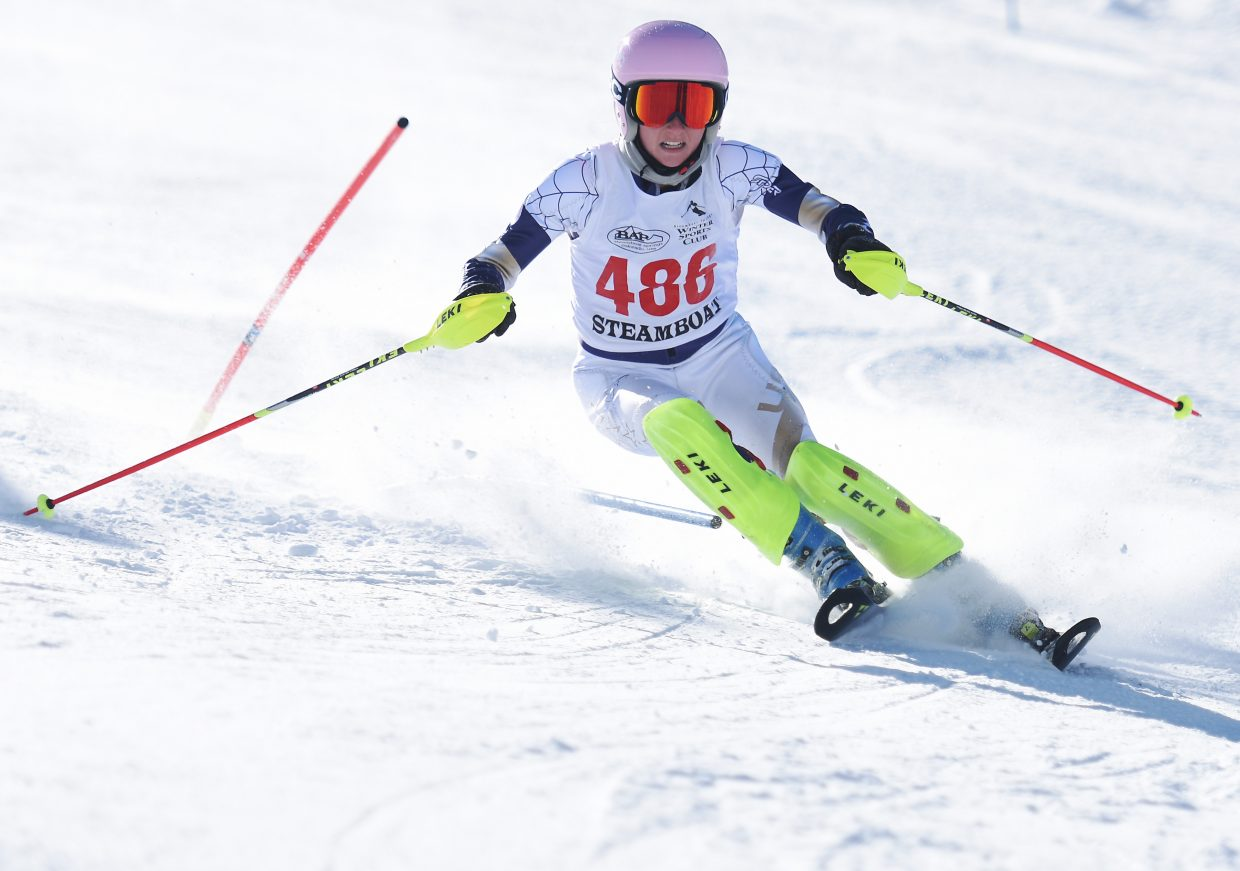 Steamboat Springs skier MacKenzie Gansmann flies down Howelsen Hill on Friday. Gansmann won the slalom race, her third win in a high school skiing event this season.