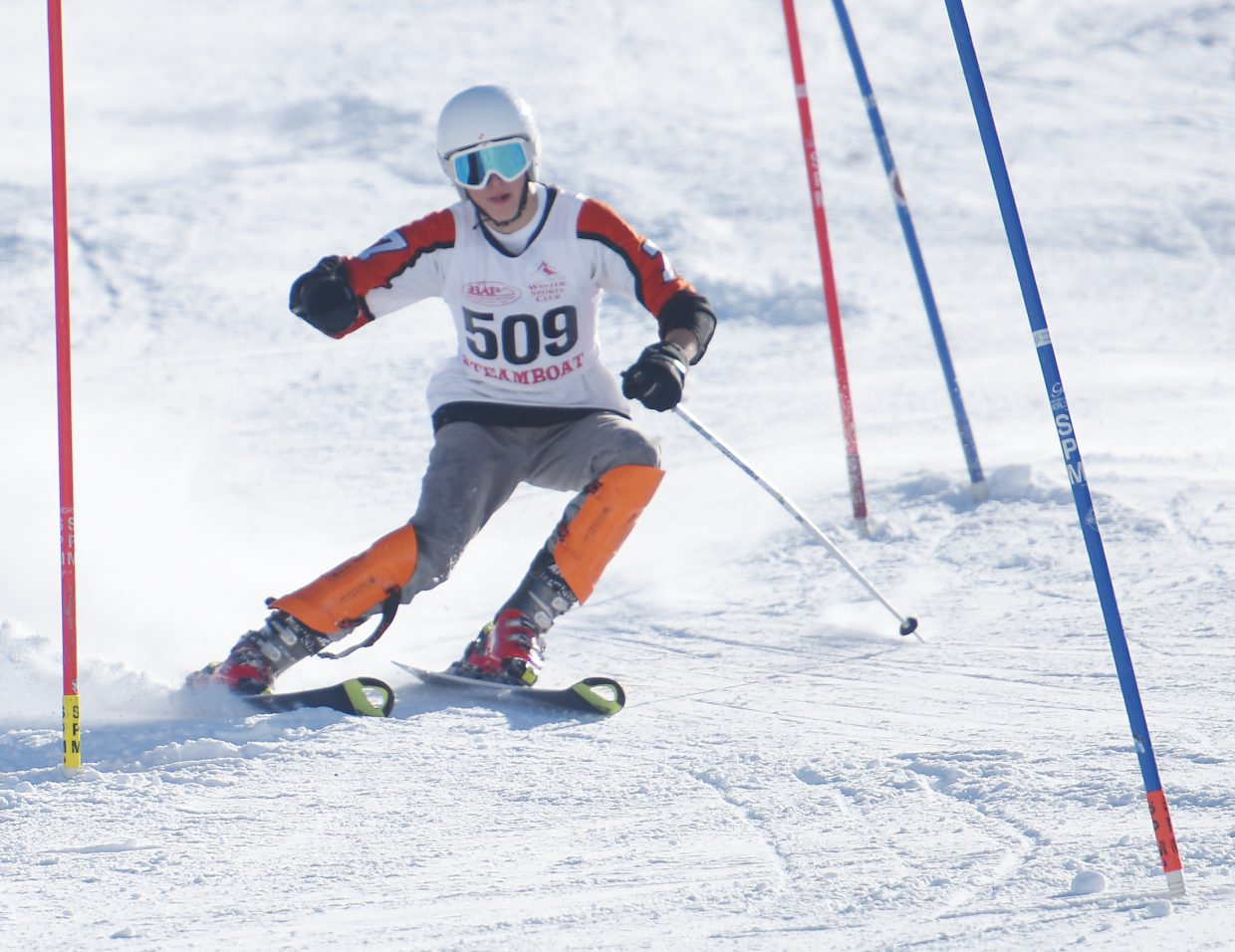 Steamboat Springs skier Connor Channing navigates his way through gates during a slalom race at Howelsen Hill. Channing was racing with one pole in the event after he broke his hand in a recent skiing accident.