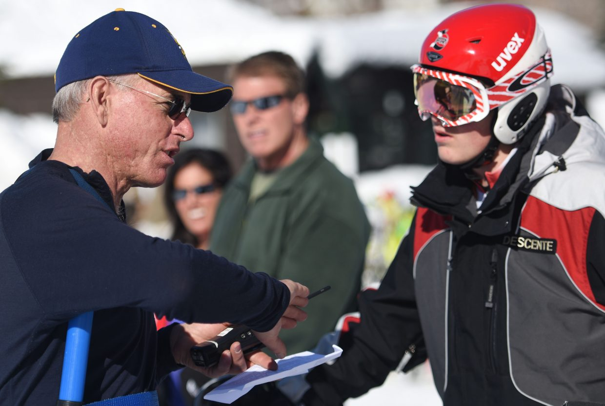 Steamboat Springs High School alpine skiing coach Mike Farny offers some advice to Sailors' skier River Ludwick on Friday before a high school slalom race at Howelsen Hill.