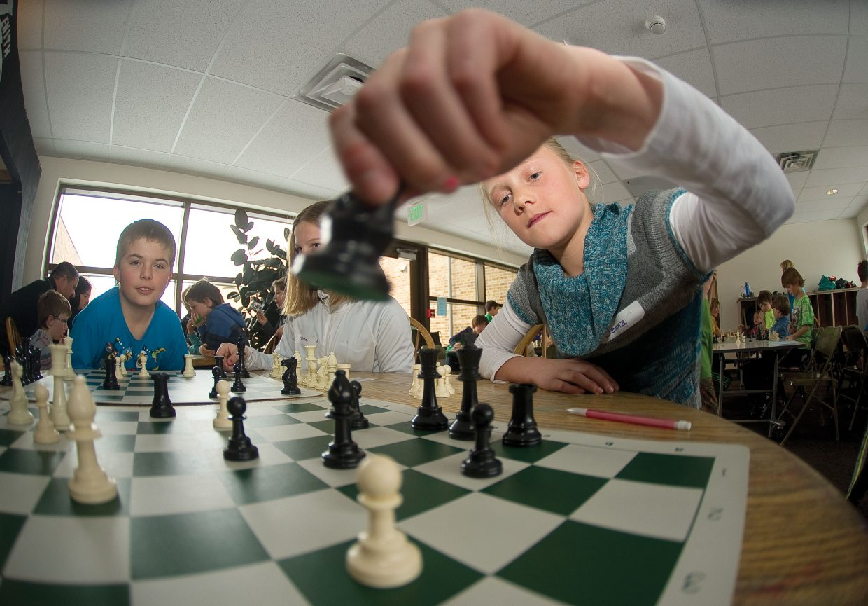 Strawberry Park Elementary School fifth-grader Jenna Smith makes her move during a chess tournament. More than 50 students took part in the tournament, which is one of the largest ever for the school-based chess program.