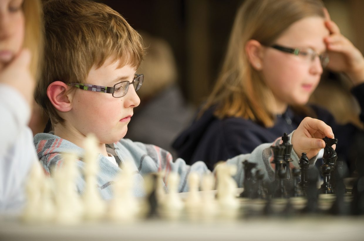 Strawberry Park Elementary School student Ryan Kitchen makes his move during a chess tournament. More than 50 students took part in the tournament, which is one of the largest for the school-based chess program.