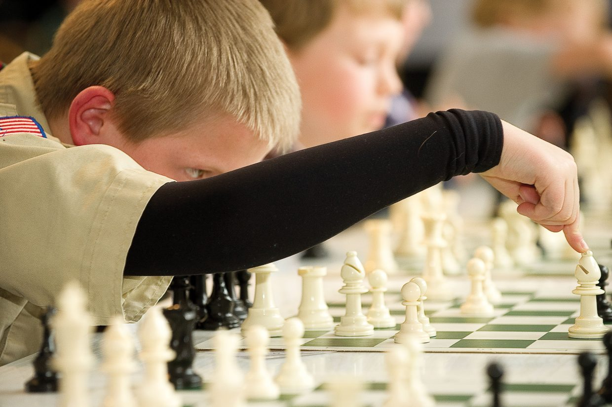 Strawberry Park Elementary School student Paxton Sollars makes his move during a chess tournament.