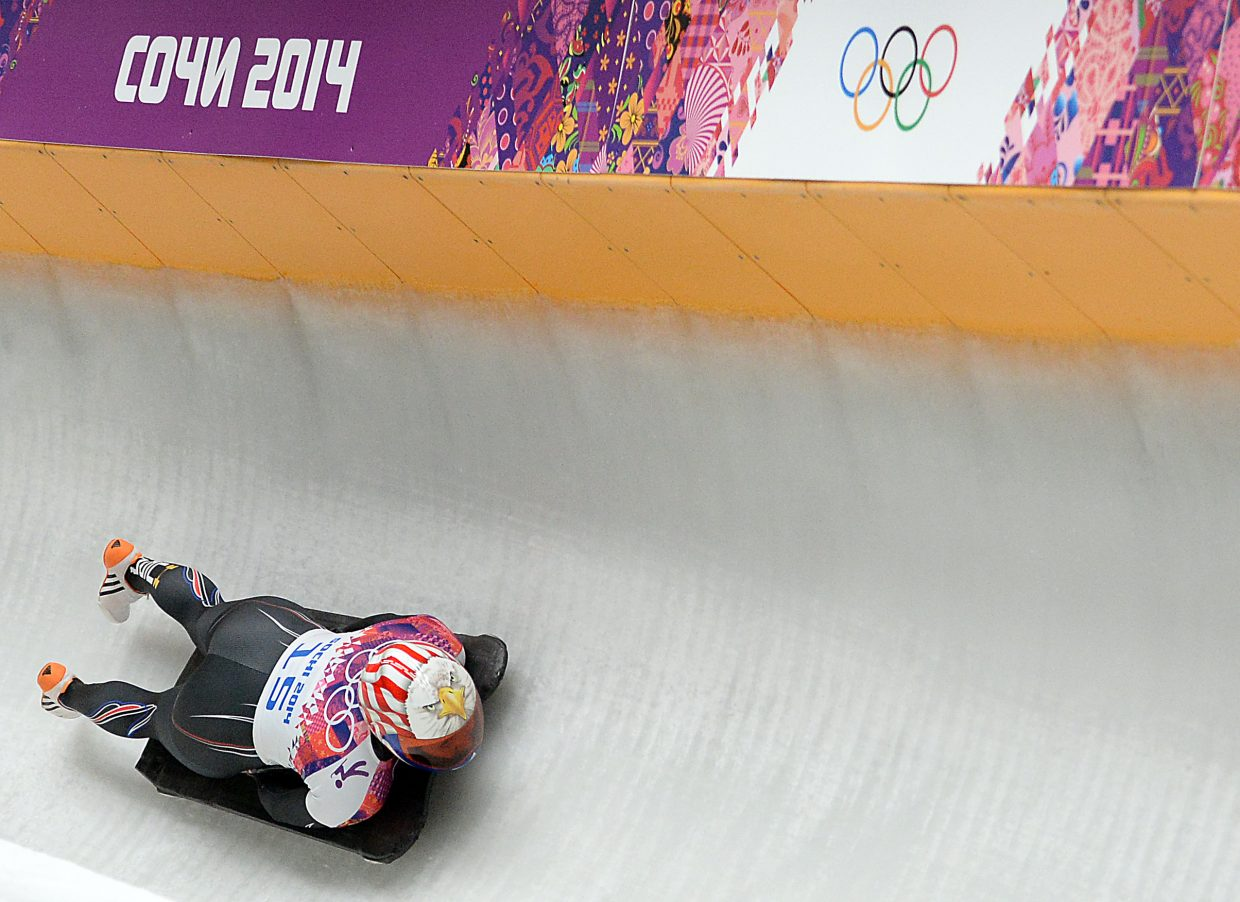 Katie Uhlaender rides around a corner high on the track at the Sanki Sliding Center in Krasnaya Polyana, Russia. Ulaender, who splits time between Breckenridge and a western Kansas cattle ranch, finished fourth in the event.