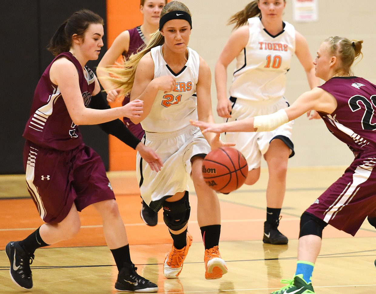 Hayden's Jewel Vreeman tries to dribble through the defense of Soroco's Hayley Johnson, left, and Morgan George on Friday. The Tigers hung with the Rams, but couldn't get a lead against Soroco.