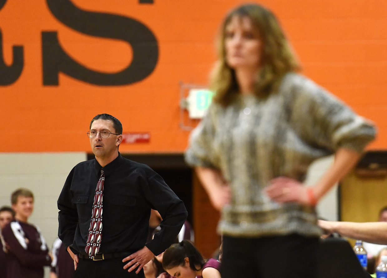 Soroco High School girls basketball coach David Bruner, left, and his Hayden counterpart, Michelle Wilkie, share concern late in Friday's game.