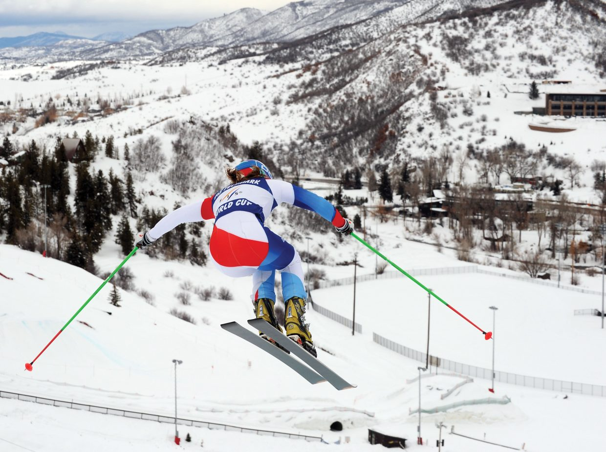 Amelie Reymond, of Switzerland, soars off a jump at the top of the Howelsen Hill racecourse Thursday during Day 3 of the Telemark World Cup in Steamboat Springs.