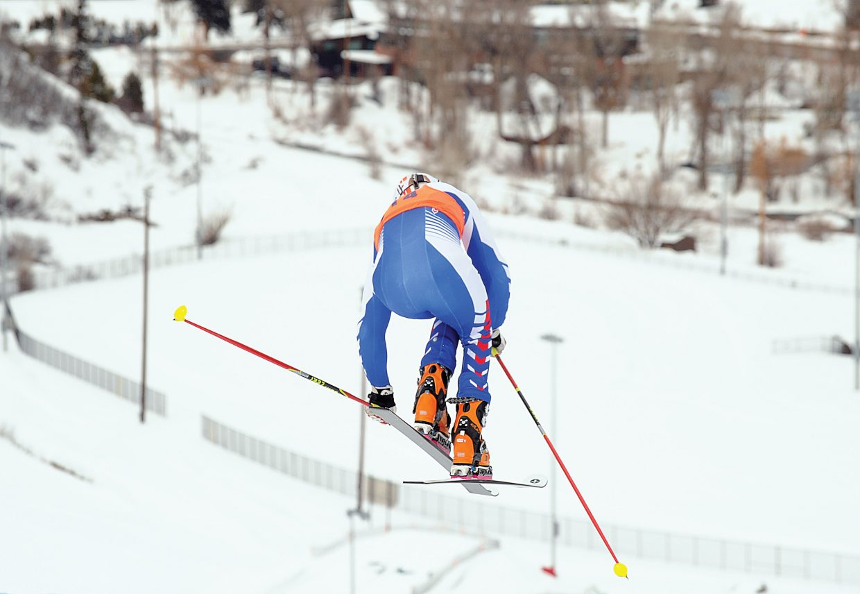 Phil Lau, of France, soars off a jump at the top of the Howelsen Hill racecourse Thursday during Day 3 of the Telemark World Cup in Steamboat Springs.