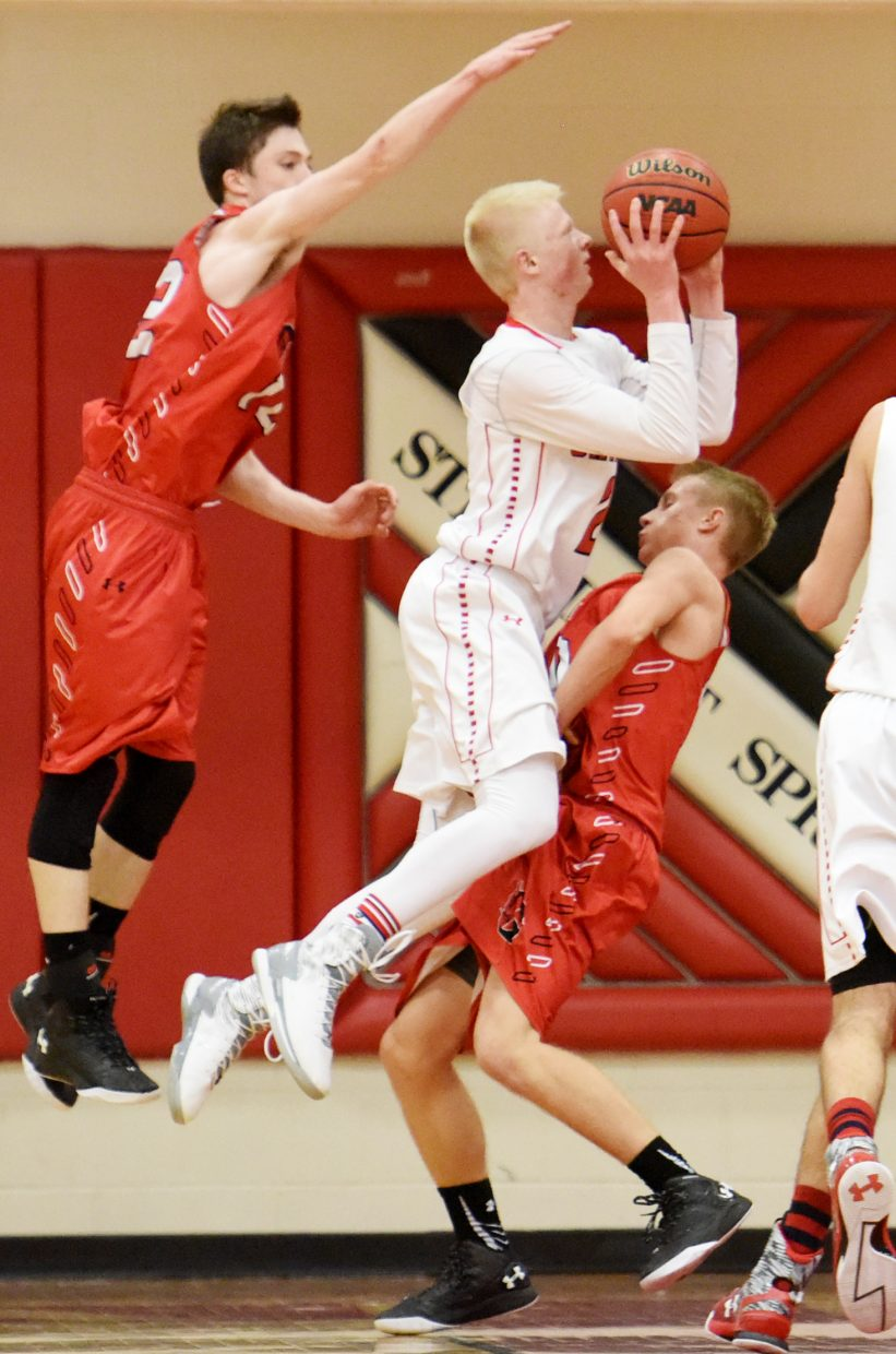 Steamboat's Ethan Riniker drives to get a shot up late in Saturday's game against Glenwood Springs. He drew a foul on the play.