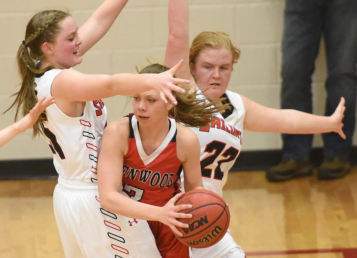 Steamboat's Tess Richey, right, and Jenna Miller try to clamp down on defense Saturday against Glenwood Springs. The Sailors lost the game, 55-36.