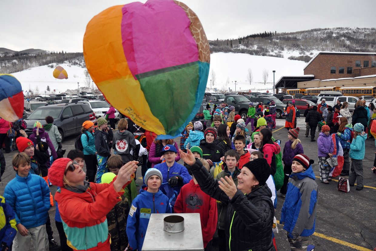 Steamboat Springs Middle School students watch their paper hot air balloons take off Friday. Students learned about the atmosphere while also having fun building and launching the balloons.