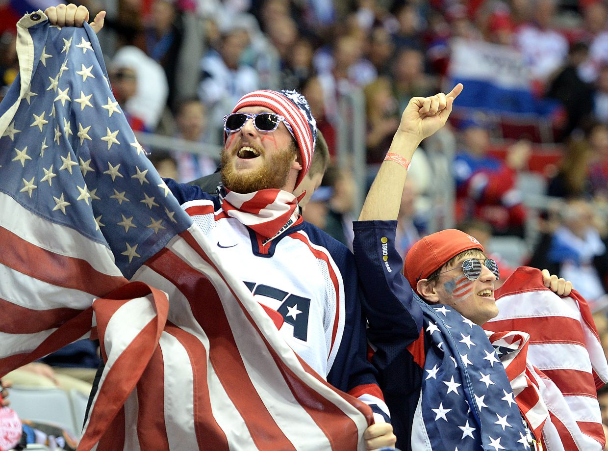 A pair of American fans cheer on the Team USA men's hockey team Saturday against Russia.