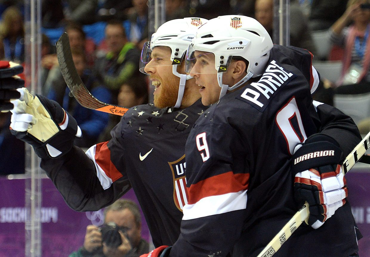 Cam Fowler, left, celebrates the United States' first goal Saturday in its showdown against Russia.