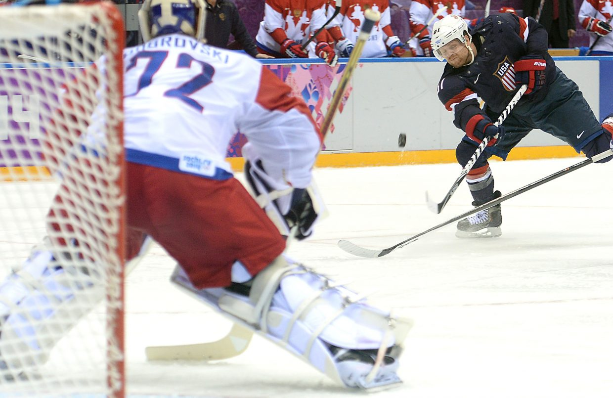 Phil Kessel launches a shot on the Russian goalie Saturday. He didn't score there, but the United States picked up its first goal of the game against Russia seconds later.