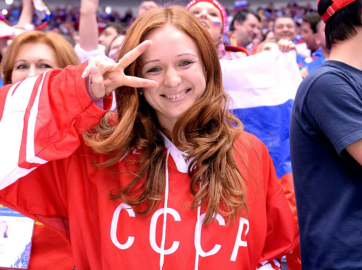 A Russian fans offers the peace sign Saturday during the U.S.-Russia men's hockey game.