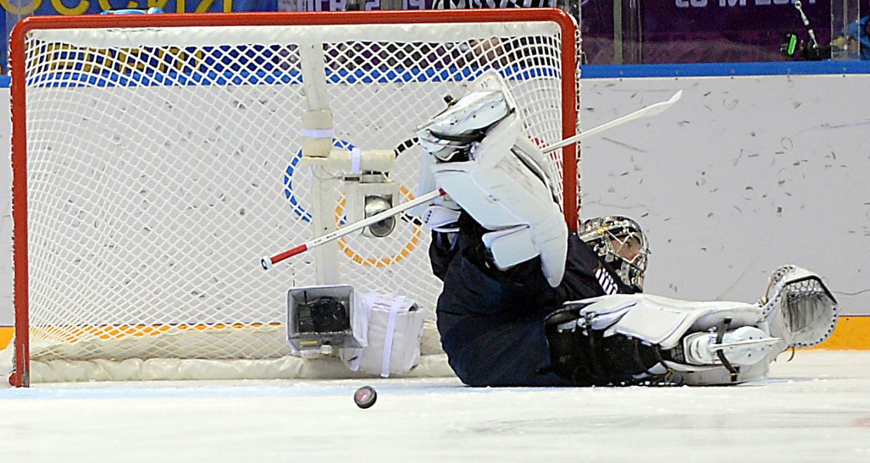 U.S. goalie Jonathan Quick rolls over to make a save on a penalty shot Saturday as the U.S. hockey team held off Russia.