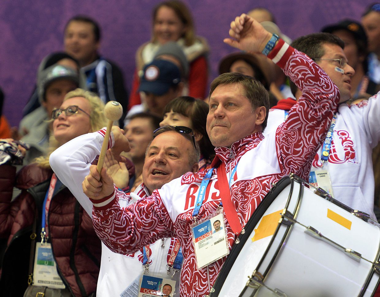 A Russian fan beats on a large drum Saturday at the U.S.-Russia men's hockey game.