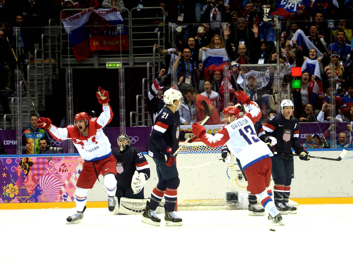 The Russian hockey team celebrates what seemed to be a go-ahead third-period goal Saturday against the United States. The score was called back, however, and the teams finished regulation tied.