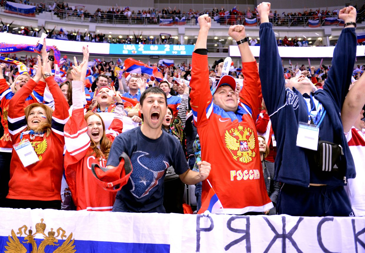 Russian hockey fans erupt after a late goal for Russia tied the score 2-2 against the United States. Team USA eventually won in a shootout.