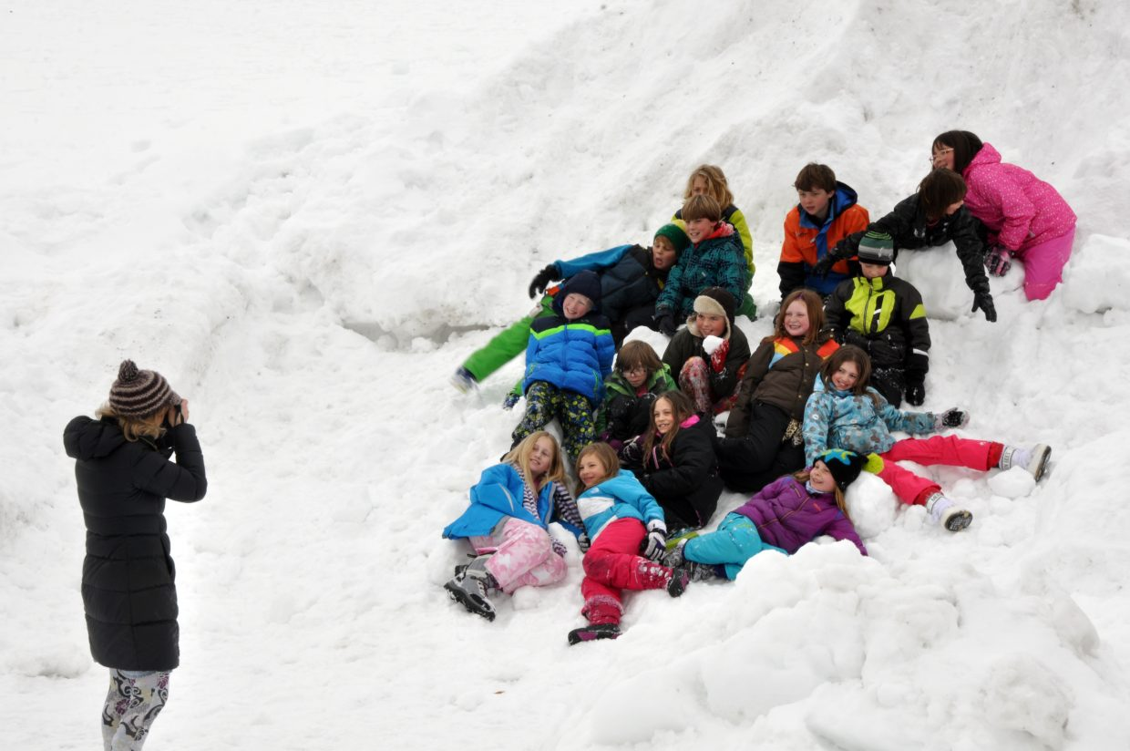 A Strawberry Park Elementary School teacher takes a picture of her students during the Winter Olympic SnowFest.