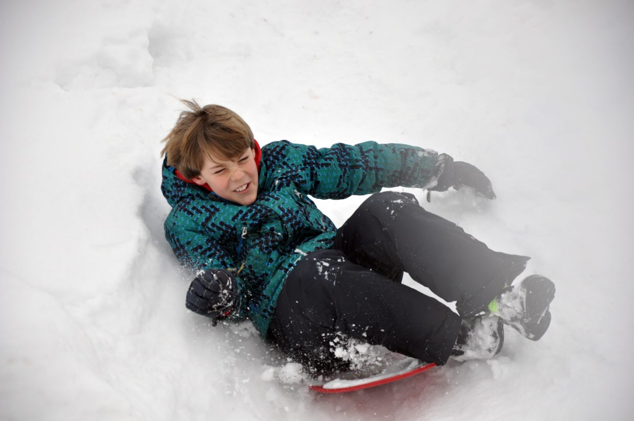 Kellen Adams sleds down a hill Friday at Strawberry Park Elementary School during the Winter Olympic SnowFest.