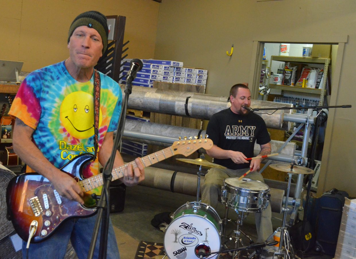The members of local group Four 2 Play Band perform at Cramer Flooring during Art Walk and Taste of Chocolate Saturday. In addition to the music, the Cramers and carpet cleaners Clean Feat provided food.
