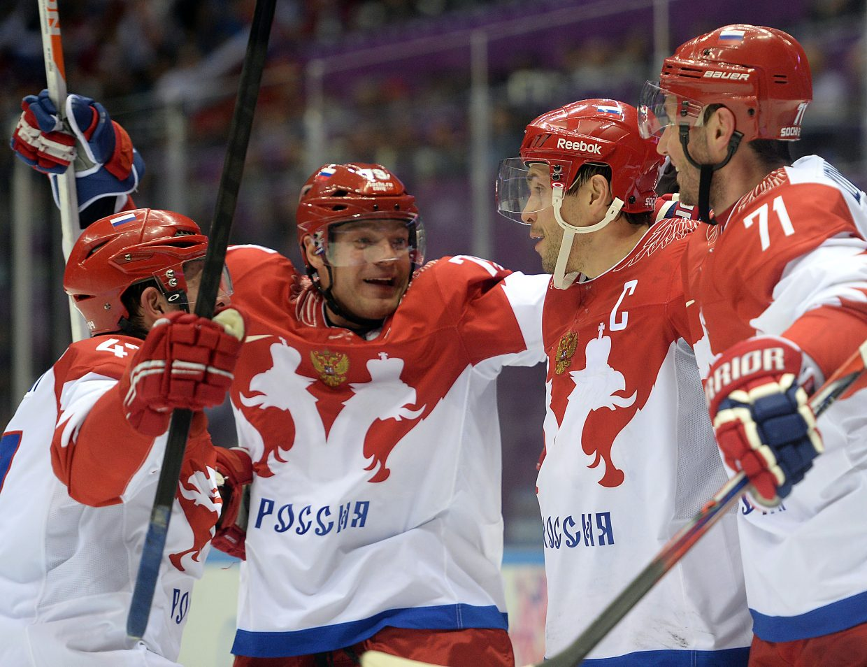 The Russian men's hockey team celebrates its first goal of the game Saturday, taking a 1-0 second-period lead on the United States.