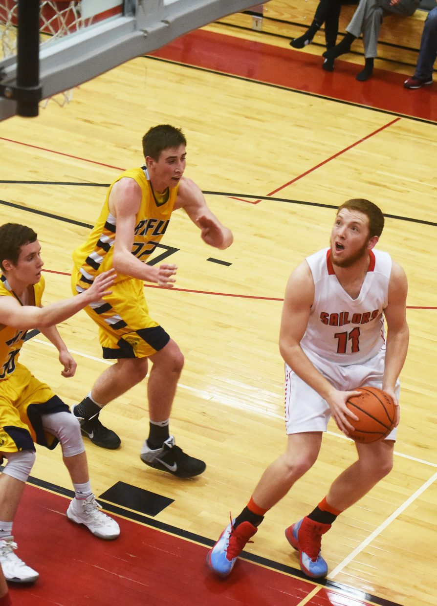 Steamboat senior Jacob Taulman looks to put up a shot Tuesday against Rifle.