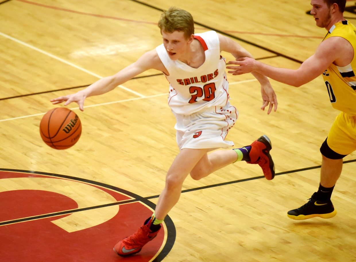 Steamboat's Mac Riniker tries to drive around the top of the key Tuesday against Rifle.