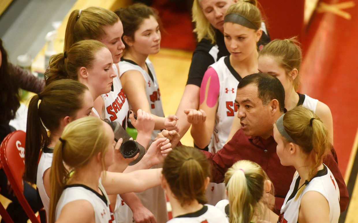 Steamboat girls basketball coach George Ibarra talks with his team during a timeout Tuesday as the team played against Rifle.