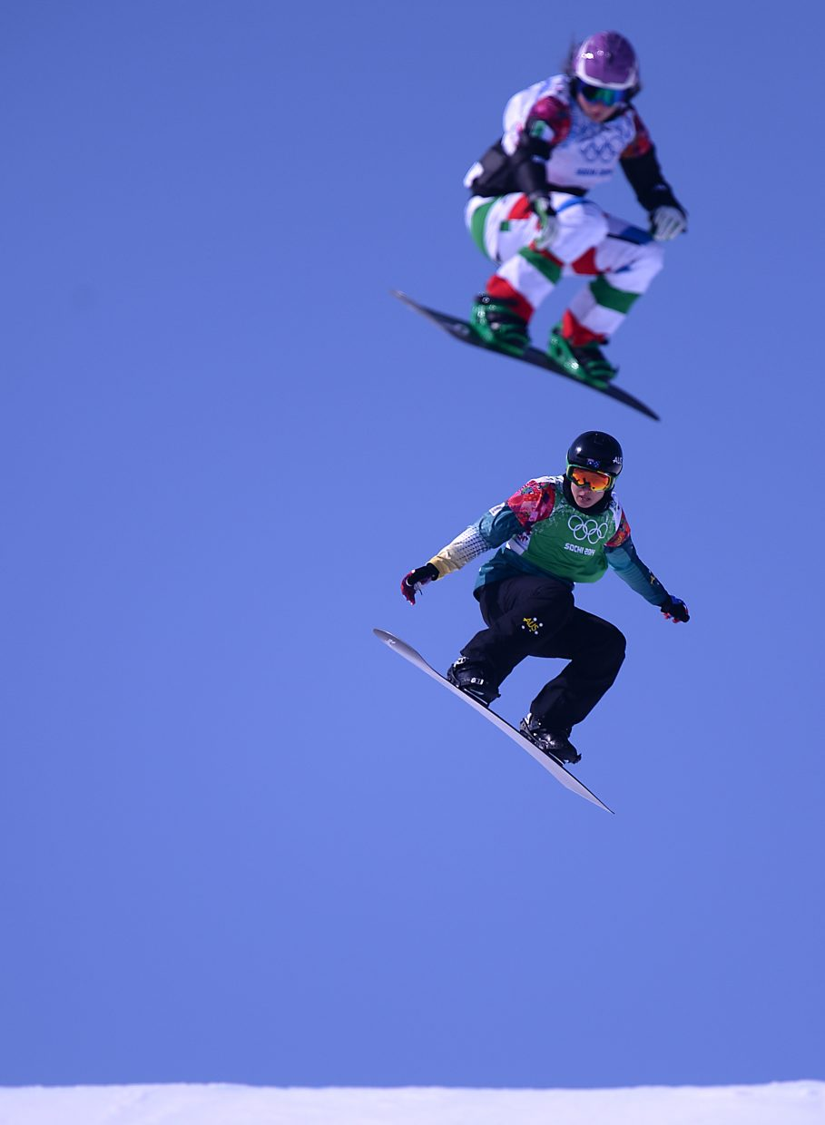 Belle Brockhoff, bottom, flies over a jump Sunday at the women's snowboard cross event at the 2014 Winter Olympics.