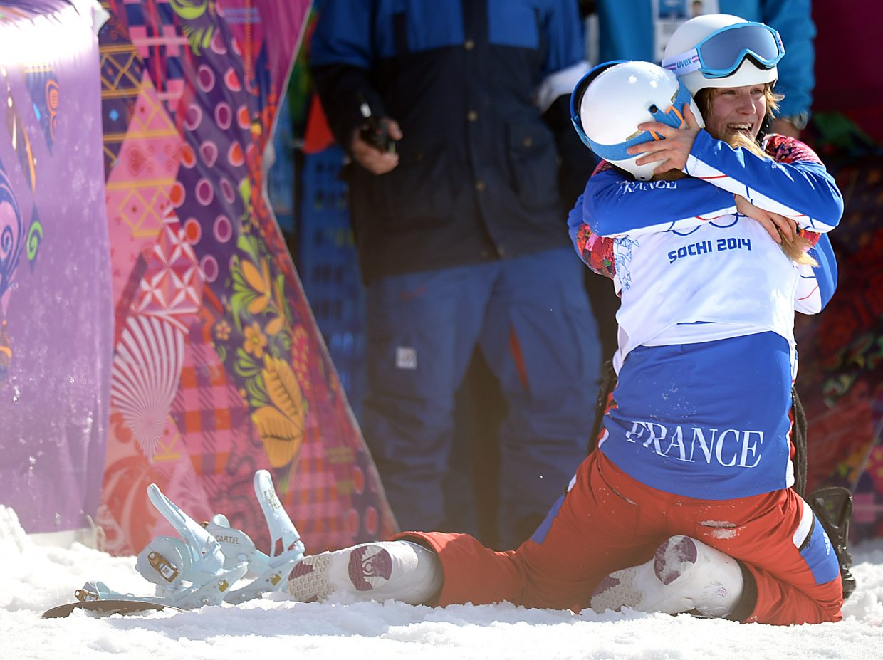 Chloe Trespeuch celebrates a bronze medal with a teammate Sunday at the women's snowboard cross event.
